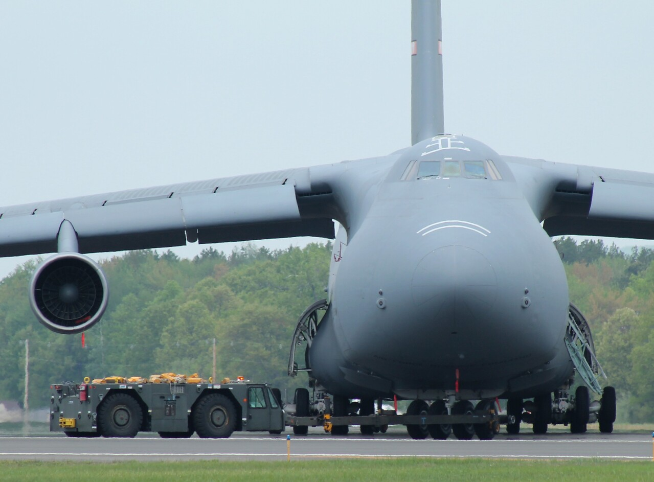 C-5 Galaxy [86-0012] gets pushed into staging area.