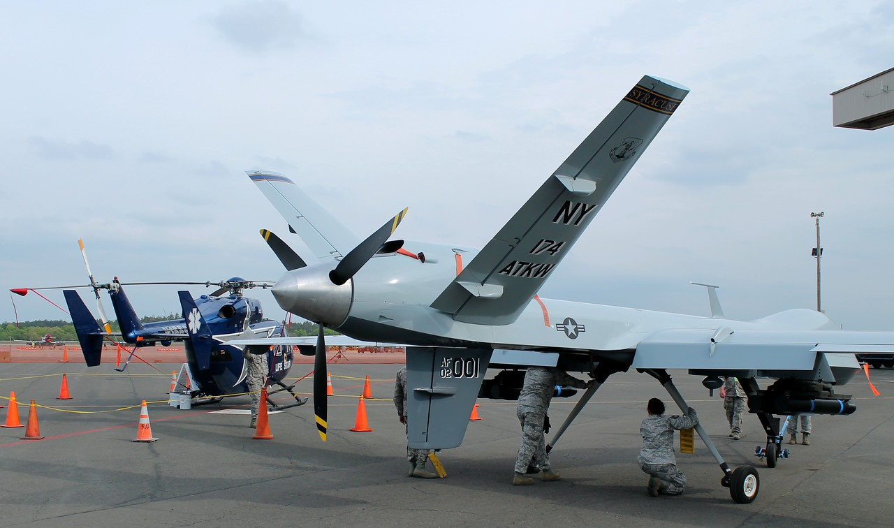 MQ-9Reaper Drone [02-001] 174 Attack Wing NY ANG get pushed into overnight hanger, passing LIFESTAR2 [N155SC]