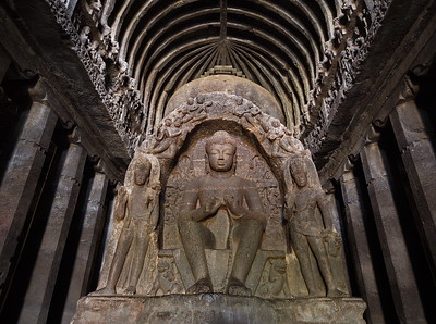 The Vishvakarma Cave, which is also know as the Carpenter's Cave due to the herringbone ceiling which looks like wooden beams. This 5m Buddha, the pillars, and herringbone ceiling are all carved into the vertical stone face.