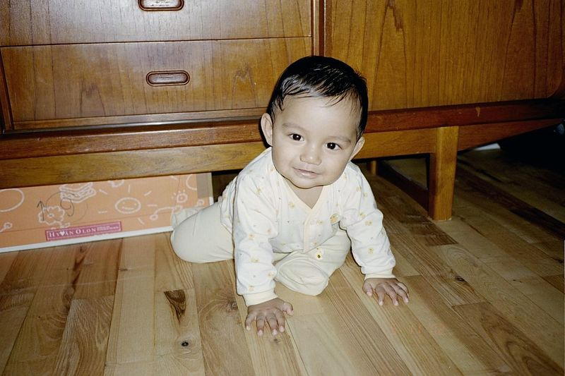 Akif learned to crawl at 10 months.  He always crawled in reverse gear and would get stuck when he hits the end of the road.