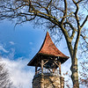 The Bell Tower was built in 1883 of rusticated stone and exposed timber and holds a 700 pound bell.