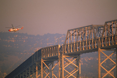 1989 Earthquake, Coast Guard Helicopter over Collapsed Section of the Bay Bridge, 1989