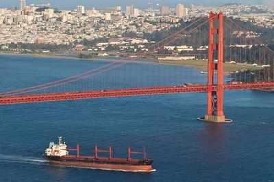 Ship traveling under the Golden Gate Bridge, San Francisco, USA