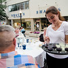 Abby Charland hands out drinks from Slattery's during the Al Fresco Fitchburg downtown dining event held on Thursday, July 20, 2017. SENTINEL & ENTERPRISE / Ashley Green