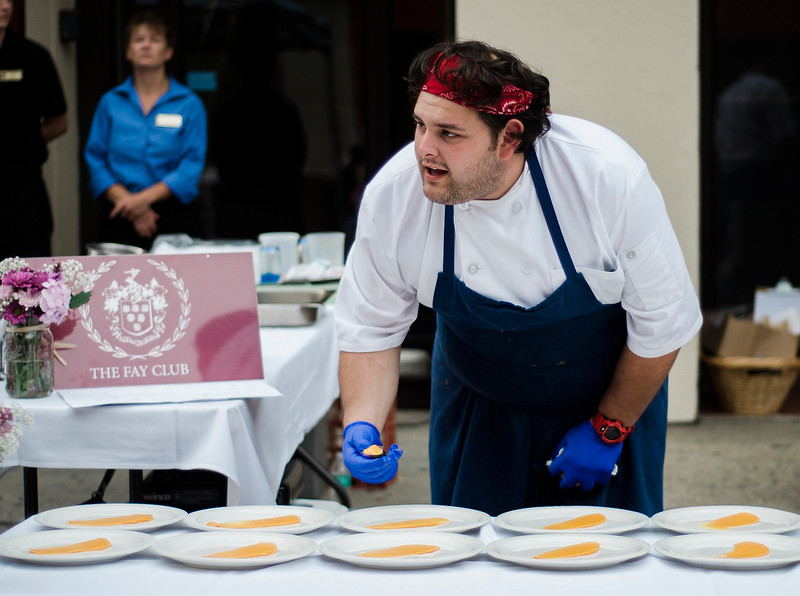 Chef Derek Brooks, of the Fay Club, prepare dinner for guests during the Al Fresco Fitchburg downtown dining event held on Thursday, July 20, 2017. SENTINEL & ENTERPRISE / Ashley Green