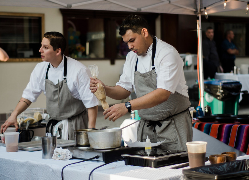 Chef Michel Coronado and Eduardo Baez, of Zapata Mexican Cocina, prepare dinner for guests during the Al Fresco Fitchburg downtown dining event held on Thursday, July 20, 2017. SENTINEL & ENTERPRISE / Ashley Green