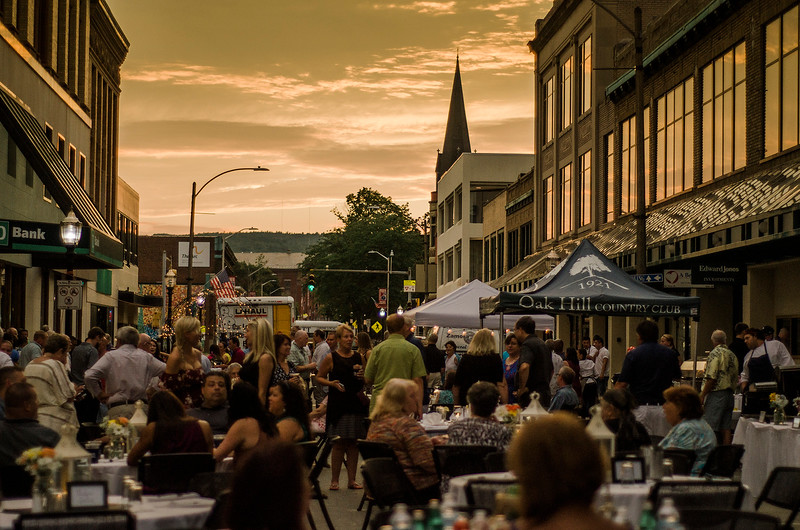 Sun sets over the downtown during the Al Fresco Fitchburg downtown dining event held on Thursday, July 20, 2017. SENTINEL & ENTERPRISE / Ashley Green