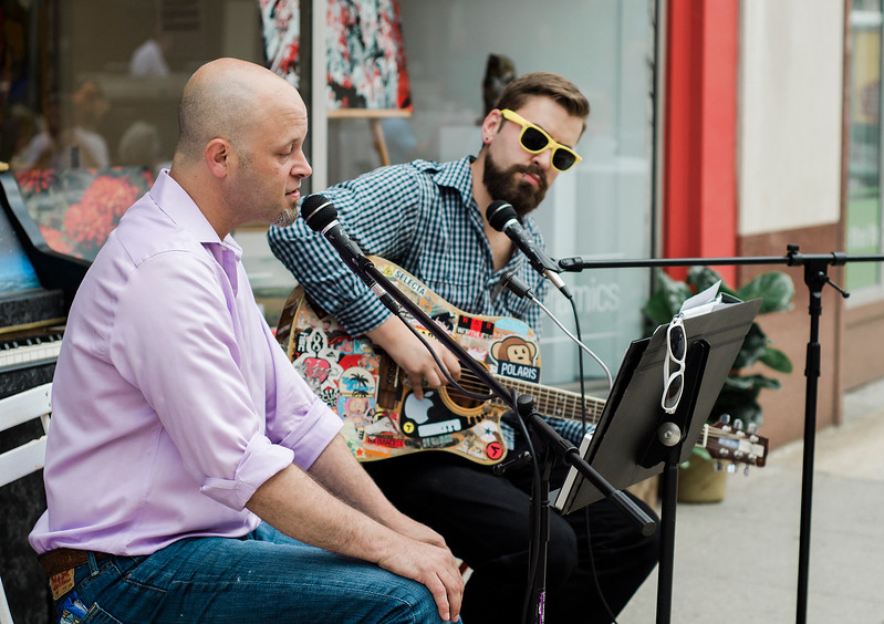Wil Darcangelo and Barny Lanman entertain guests during the Al Fresco Fitchburg downtown dining event held on Thursday, July 20, 2017. SENTINEL & ENTERPRISE / Ashley Green