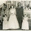 Mom and dad with flower girls, Barbara Ernst and Janie Stavinoha, her cousins