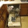 broken dishwasher used for dirty dish storage between hand washings