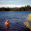 Pam and Glen taking a bath in Bear Lake north of Prince George. July 10, 1958.