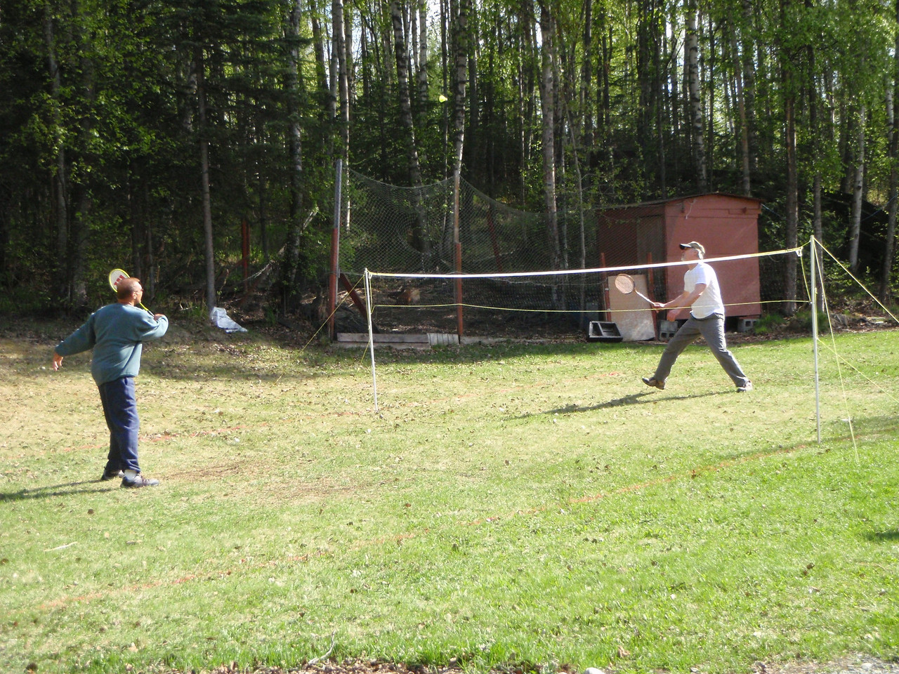Badminton in the back yard at 9PM in bright sunshine