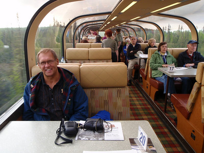 Train to Denali: Ultradome train interior with Dennis at table 20