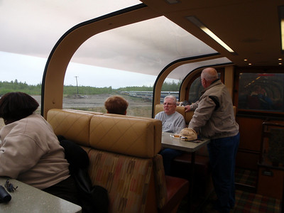 Train to Denali: interior view of train winding around the bend