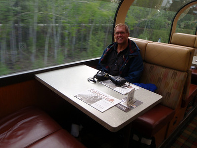 Train to Denali: train interior with Dennis at table 20
