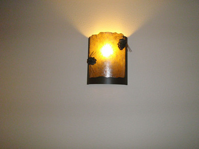 Accommodations: pinecone sconce in lodge hallway