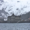 Whittier, Alaska, located 60 miles Southeast of Anchorage.  Build by the U.S. Army during World War II as a sort of secret base of operations.  Less than 300 people live here but the port is used by many such as cruise ships and those wishing to go on various excursions into Prince William Sound.