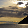 Sunset between Whittier Alaska and Anchorage.  The picture was taken while traveling on the Alaska Railroad.