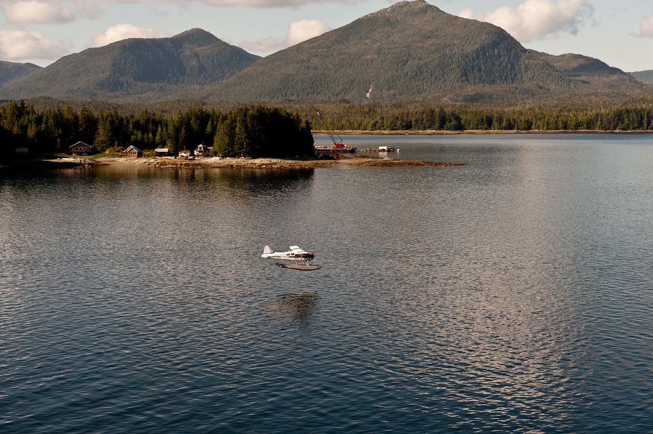 Another float plane landing in the early morning light.