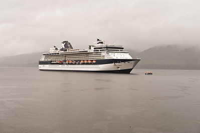 The Millennium at anchor in Icy Strait harbor. Raining.