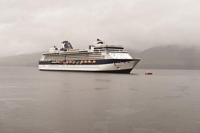 The Millennium at anchor in Icy Strait harbor. Raining.