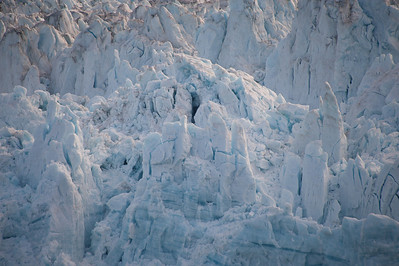 Cracked ice spires at the top of the glacier.