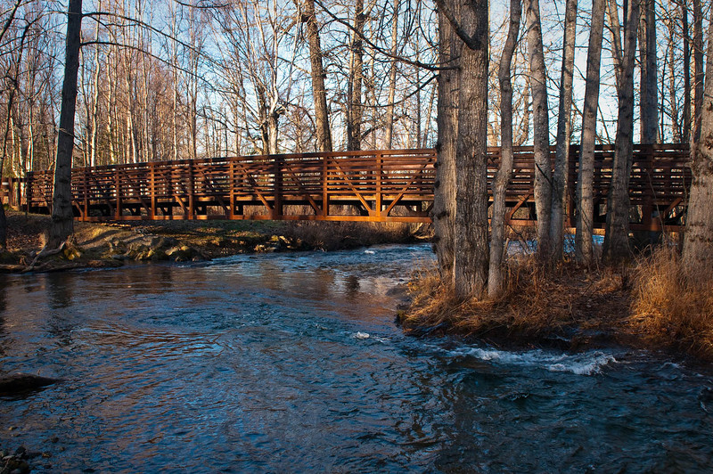 Small footbridge across Campbell Creek, Anchorage, Alaska in late October.  This park is very active with dog mushers in winter.