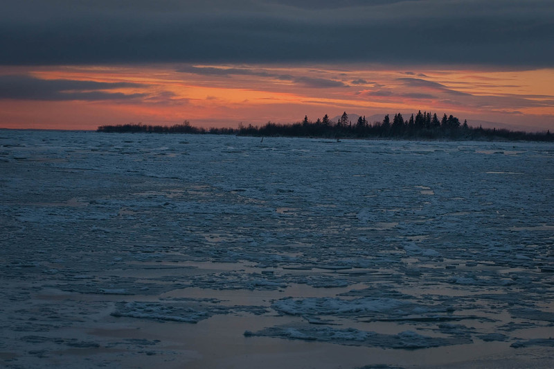 "Sunset at Knik River - looking toward Mount Susitna (also called ""Sleeping Lady"") behind the island."