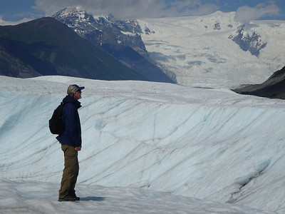 Surface of the glacier is good for walking, so we head out to explore.