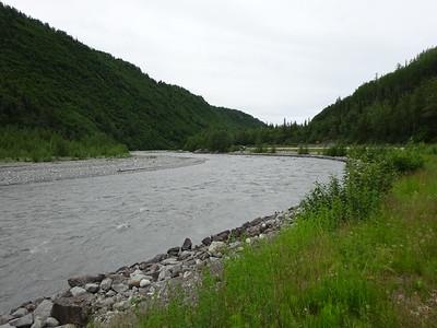 The road follows glacial rivers as we head toward the mountains.