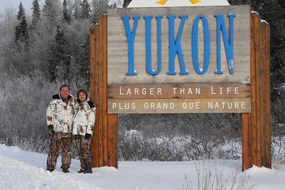 Carol and I as we enter the Canadian Yukon.