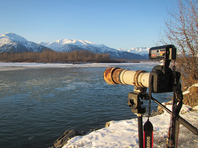 My Canon camera with a sony camera mounted on top pointed toward the Chilkat River.