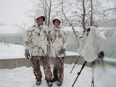 Here Carol and I are wearing camo, the pants were from Sportsman Warehouse, the coats came from Bass Pro.  Both are 100% water proof.  Under this we were wearing Under Armor 2.0.   Our boots were Muck boots rated for  -60 degrees.