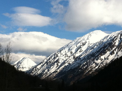 Snowcapped mountains across Ressurection Bay, along the Seward Highway.