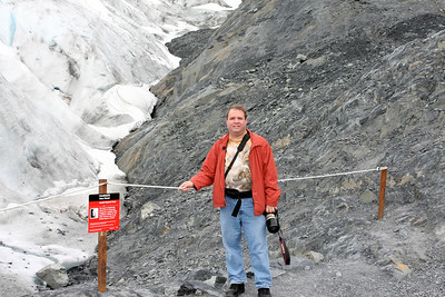 Gary standing along the side of Exit Glacier.
