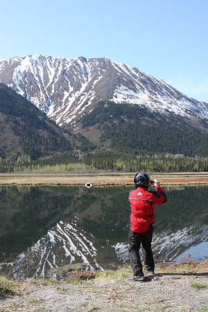 Motorcyclist stops to take pictures of the mountain range at Bird Point.