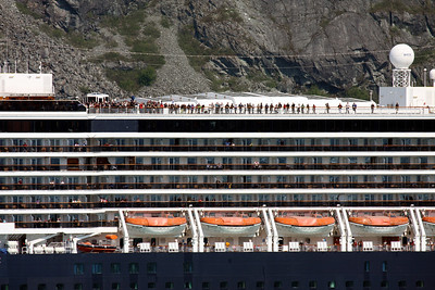 People lining the decks of the ms Osterdam as they approach Marjorie Glacier and we depart.