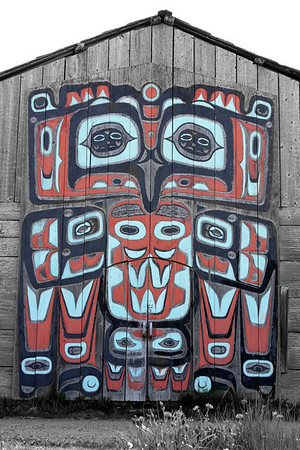 Totem carved doors on a building in Haines, AK.