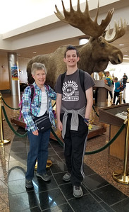 Susie and Jaden have just gotten off the plane in Anchorage.  I guess the stuffed moose behind them gave their location away.