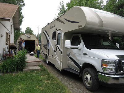 """Our friend Mary, whom we had not seen in 7 years, offered to let us """"camp"""" in her driveway for Saturday night.  The RV, 8 feet wide and 24.5 feel long, made for an """"interesting"""" time backing into her driveway."""