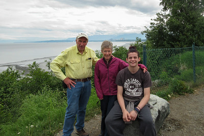 Desperately needing some exercise, we drove over to the Tony Knowles Coastal Trail on the bluffs above Knik Arm.  A nice woman offered to take our photo together, so here it is.