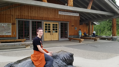 As it had taken us awhile to get to the Park, no one seemed up for a real hike, so we walked the 1+ miles to the visitor center.  Jaden obliged by getting on a grizzly bear sculpture.