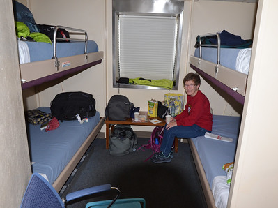"""If you were wondering what """"staterooms"""" are like on the Ferries, well, wonder no more.  We sprung for a four-bunk room (to have more room for luggage) and a window, which is covered to slow heating from the rare sunshine.  And yes, the room has a bathroom with shower."""