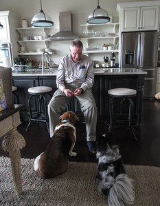 """Roger, better known as """"Bacon Man"""" to the dogs, brought them some real bacon.  Lucy is on the left, and Oliver, the crazy one, is on the right."""