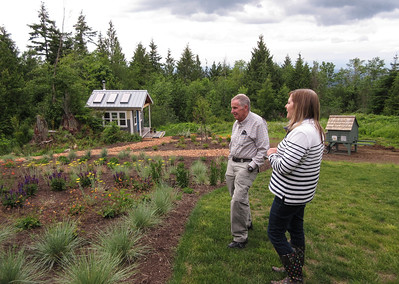 Roger and Barbara surveying some landscaping they have been working on.  We have known Barbara for more than 25 years.