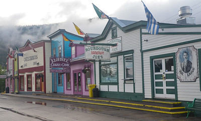 At 4:45 am, we were awakened by the caravan of RVs starting their engines (to get in line for the ferry).  So, despite the yucky weather we left Dawson at 6:45 am.  Here are some of the shops along the Main drag in Dawson, as we head to  Tombstone Territorial Park.