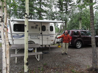 Our campsite at the Tok RV Village.  It had just stopped raining when we arrived, so we put out the awning so that Roger could process that salmon we were given in Valdez.