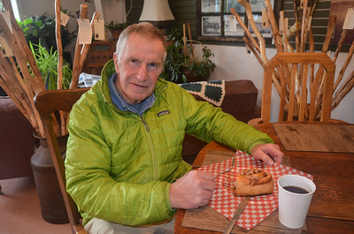 Roger enjoying a nice bun with coffee.  And yes, he ate the whole thing.  As Susie did hers.