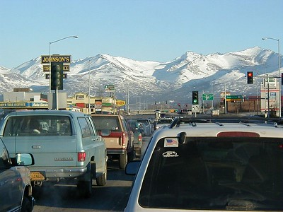 "The snow on the mountains lets you know this is not Los Angeles, but the traffic is typical of ""Los Anchorage""."