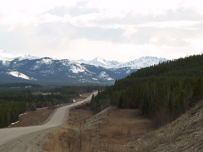 This is in upper British Columbia, not quite to the Yukon Territory. This just gives you an idea of how desolate and beautiful the scenery is, even before spring has greened up the region. The road is paved although it doesn't quite look like it in this scene.